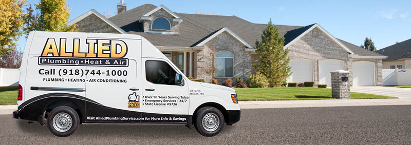 Allied Plumbing service truck in front of home contact us